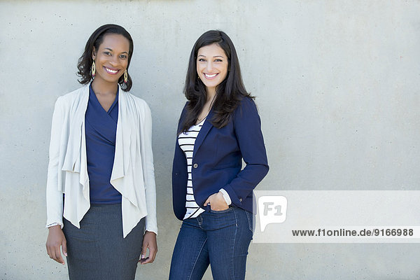 Businesswomen smiling together