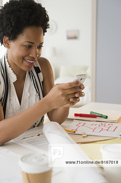 Black businesswoman using cell phone