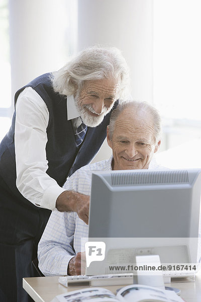 Senior Caucasian businessmen working together in office