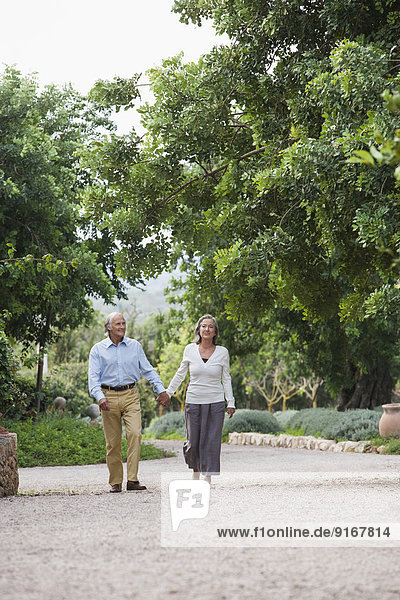 Couple walking together outdoors
