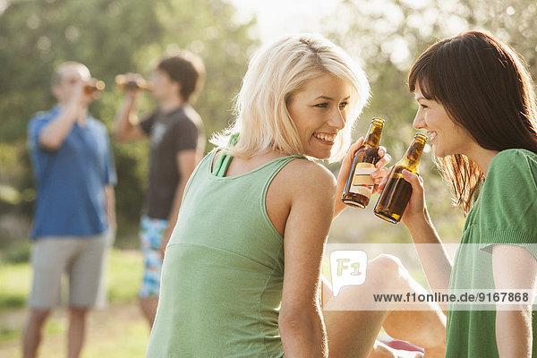 Women drinking beer outdoors