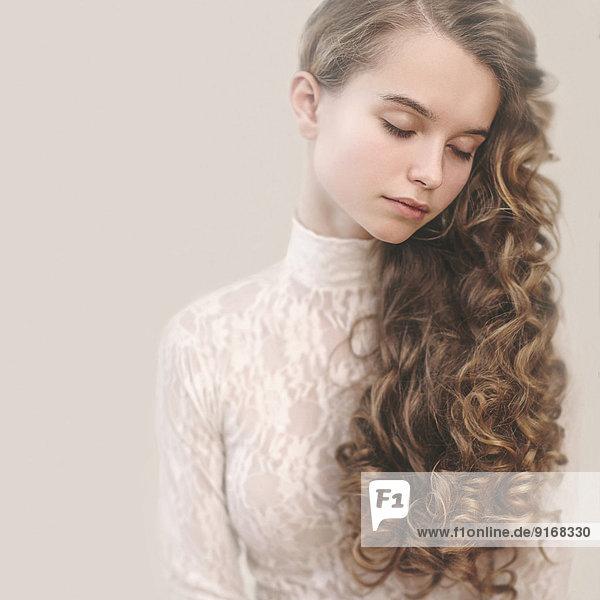 Calm Caucasian girl with long hair Calm Caucasian girl with long hair
