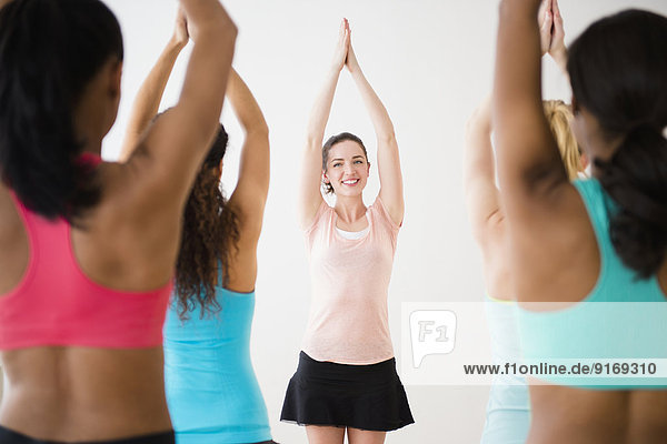 Women practicing yoga in class