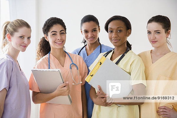 Nurses smiling together in hospital