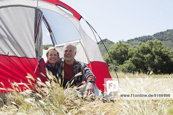 Senior Caucasian couple relaxing at campsite