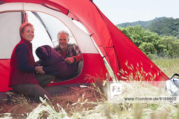Senior Caucasian couple packing up campsite