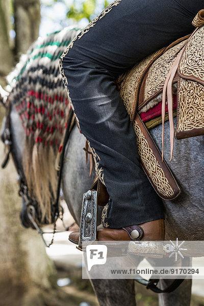 Caucasian man riding horse