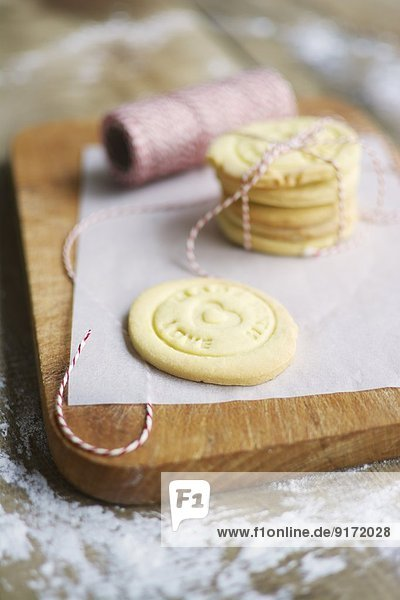 Stack of home made almond cookies on a cutting board Stack of home made almond cookies on a cutting board