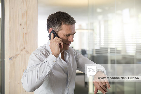 Portrait of business man telephoning with smartphone