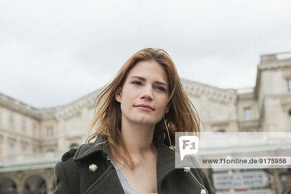 France  Paris  portrait of young woman with ear phone