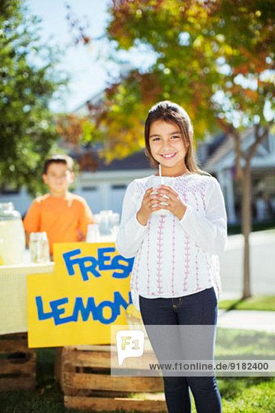 Portrait of smiling girl at lemonade stand