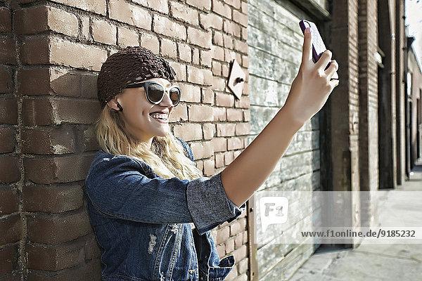 Frau Fotografie nehmen Straße Großstadt