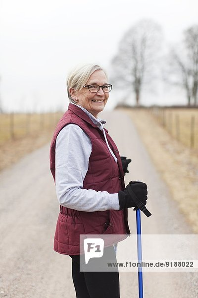 Senior woman with walking poles