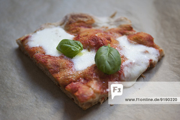 High angle view of fresh pizza with mozzarella cheese and basil