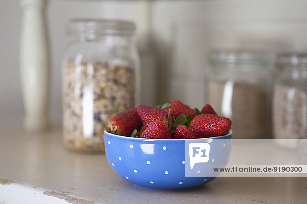 Bowl of strawberries on kitchen counter