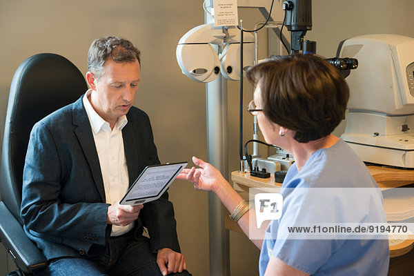 Male patient having eye examination in an optometrist clinic