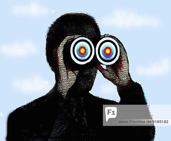 Geschäftsmann schaut durch ein Zielscheiben-Fernglas