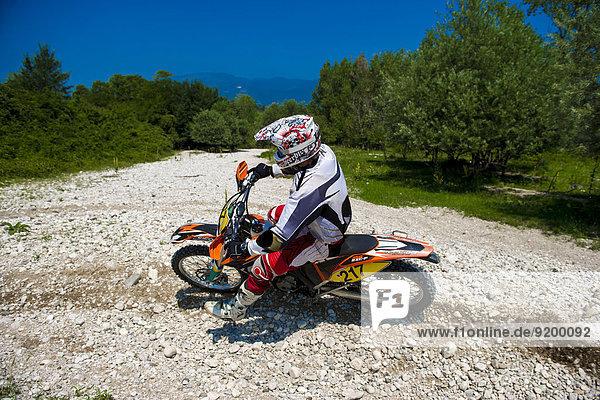 Young Man Riding Motocross Bike in Italian Countryside