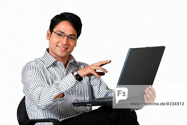 A corporate working on laptop  Pune  India.
