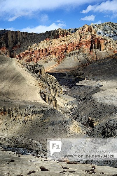 Mineral landscape with red rocks near the village of Ghemi. Nepal  Gandaki  Upper Mustang (near the border with Tibet).