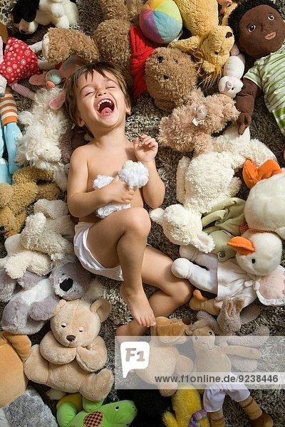 Spielzeug belegt umgeben 2 Baby alt