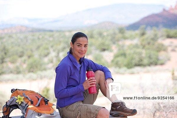 Portrait of mature female hiker with water bottle  Sedona  Arizona  USA