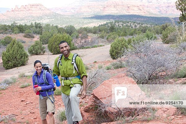 Couple with water bottles out hiking  Sedona  Arizona  USA