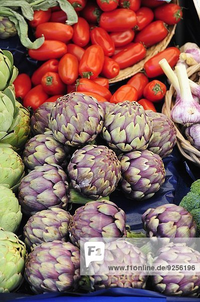 Artichokes and tomatoes on a market stall