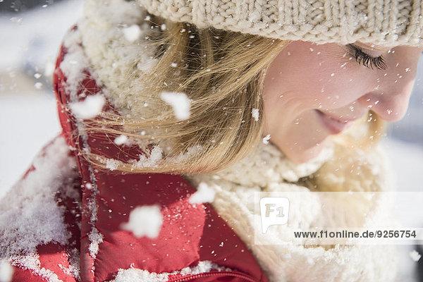 Profile of woman wearing knit hat in winter