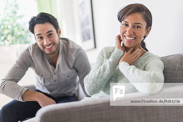 Couple relaxing together on sofa