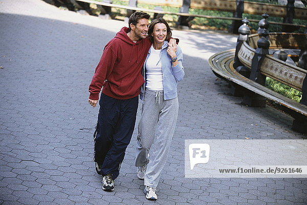 Couple walking in urban park