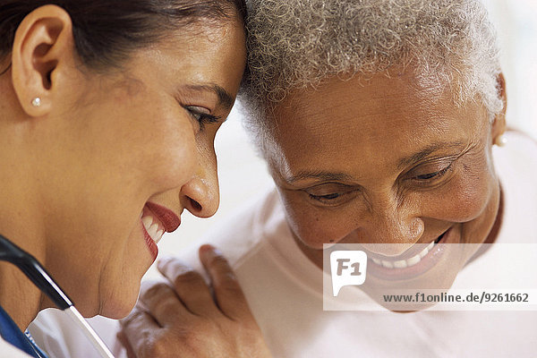Nurse talking to Senior patient in hospital