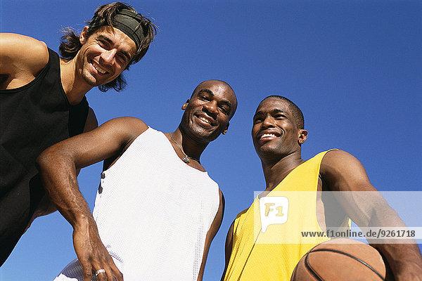 Men smiling on basketball court