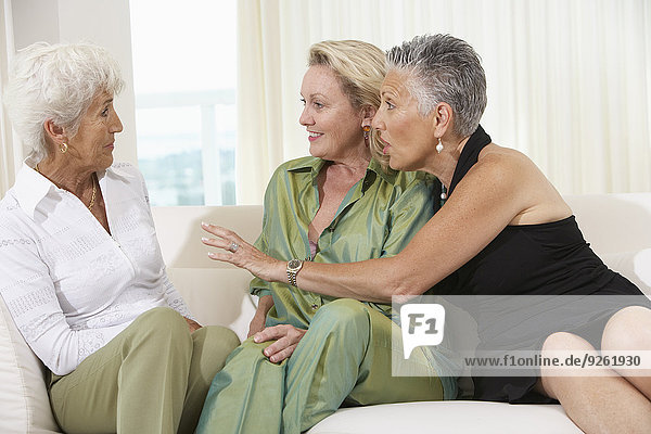 Senior women talking on sofa