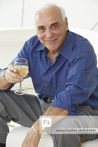 Senior man drinking glass of wine