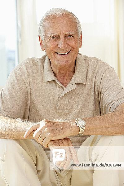 Senior man sitting on sofa