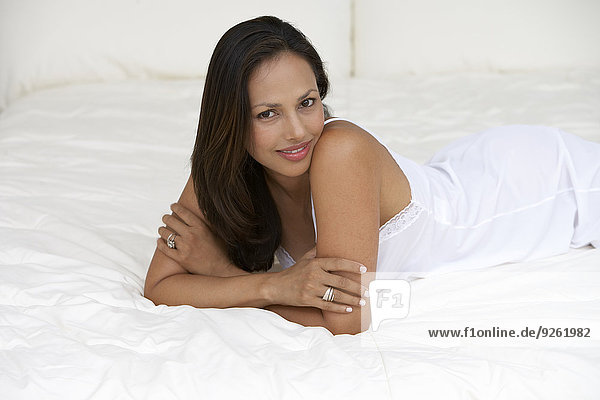 Indian woman laying on bed