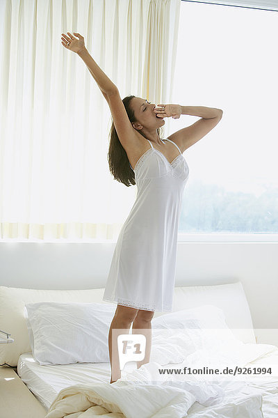 Indian woman stretching on bed