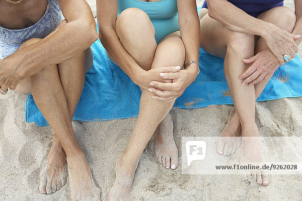 Senior women sitting on beach