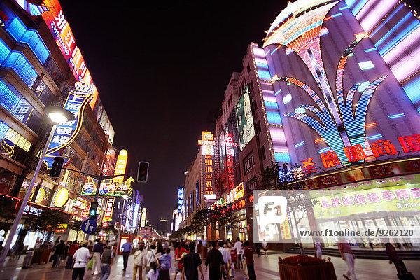 City street lit up at night  Shanghai  China