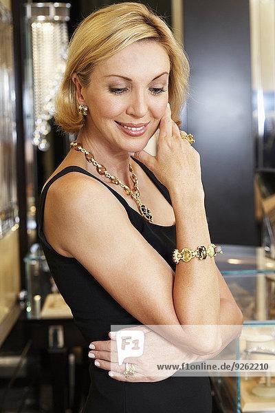 Woman wearing jewelry in store