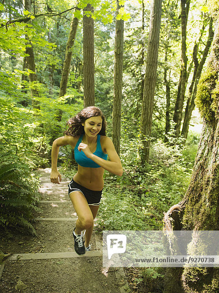 Young woman jogging in forest