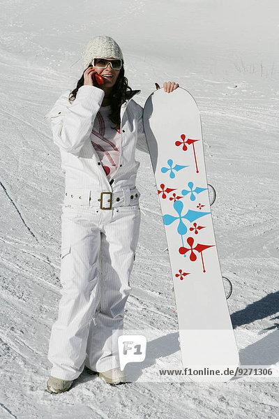 Handy Frau Snowboard sprechen