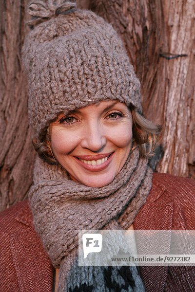 Mature woman wearing a hat and scarf