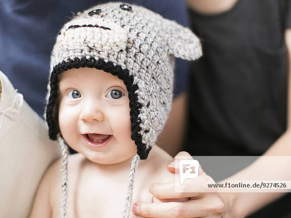 Portrait of baby boy (2-5 months) wearing knit hat