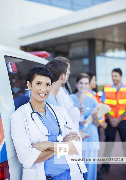 Doctor smiling outside hospital