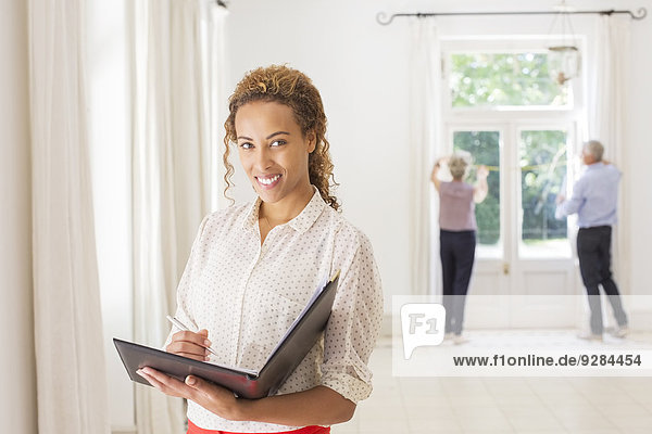 Woman holding binder in living space