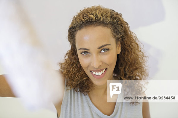 Woman smiling indoors