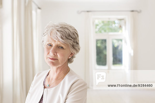Older woman in empty living room