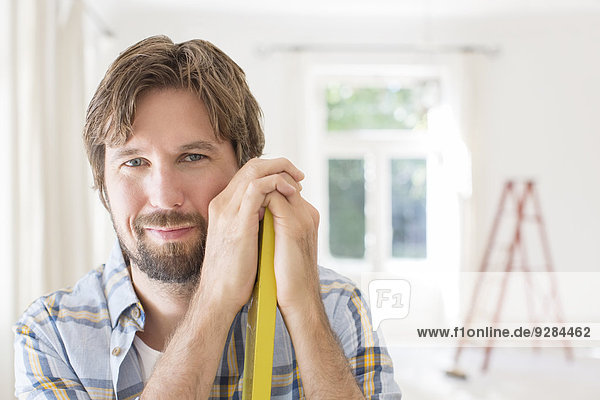 Man smiling in living space